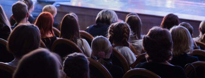 Children in an theater audience