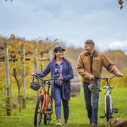 Couple enjoying the vineyards with bikes, Galena Cellars © Illinois Office of Tourism