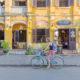 Tourist riding down street of Hoi An, Vietnam