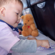 Toddler coloring on airplane