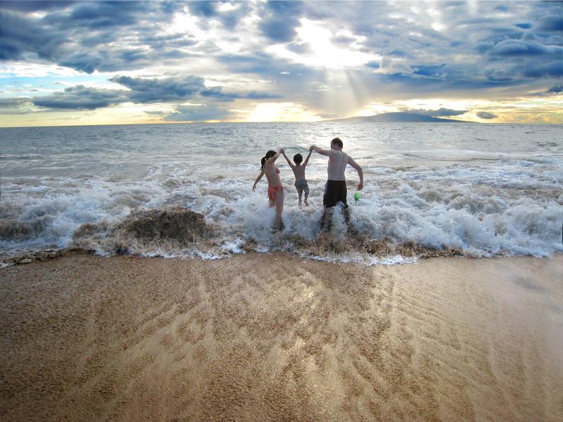 Family on the beach in Maui