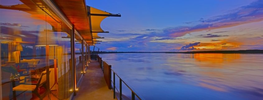 Cruise during sunset at Amazon River, Peru © Yasushi Tanikado | Dreamstime.com