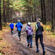 Family running in the forest, fall © Nikolai Vakhrushev   Dreamstime.com