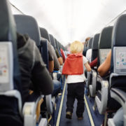 Little boy on flight running up the aisle © Marysmn | Dreamstime.com