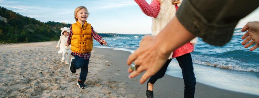 Kids at the beach in fall © Anna Kraynova | Dreamstime.com