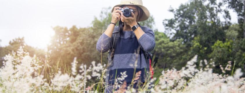 Taking photographs on vacation © Sawitri Khromkrathok | Dreamstime.com