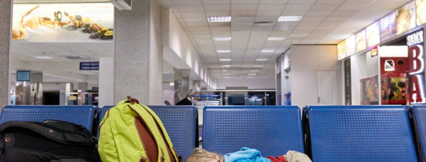 Kid sleeping at the airport © Denys Kurbatov | Dreamstime.com