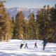 Family Skiing Down Mountain © The Ritz –Carlton, Lake Tahoe
