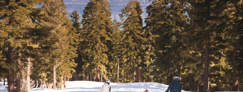 Family Skiing Down Mountain © The Ritz –Carlton, Lake Tahoe