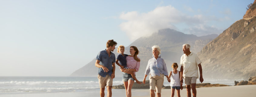 Multi Generation Family On Vacation Walking Along Beach Together © Monkey Business Images | Dreamstime.com