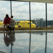 Family looking at Spirit Airlines Aircraft