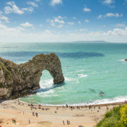 Tourists at Durdle Door Beach on the Jurassic Coast of England © Fuzja44 | Dreamstime.com