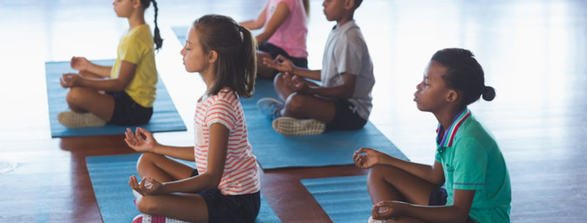 Kids meditating © Wavebreakmedia Ltd | Dreamstime.com