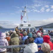 Tourists on Loch Ness cruise in Scotland
