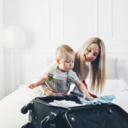 Mother and child packing © Tommyandone | Dreamstime.com