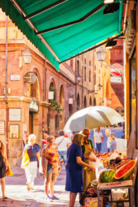 Tourists and locals go shopping in medieval market, Quadrilatero. The Quadrilateral Area, was born in Middle Ages, Bologna, Italy © GoneWithTheWind | Dreamstime.com
