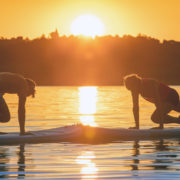 Family doing yoga on paddleboards © Mmerpics | Dreamstime.com