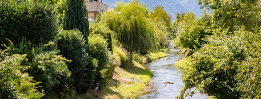 The Oberaukanal flowing through the outskirts of Vaduz, Liechtenstein © Ben Gingell | Dreamstime.com