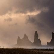 Family visiting the Troll Rocks in Vik, Iceland © Dodi Sandradi   Dreamstime.com