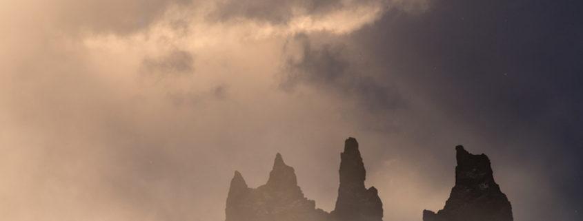 Family visiting the Troll Rocks in Vik, Iceland © Dodi Sandradi | Dreamstime.com