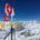 Wind vane (weathercock) on top of Klein Matterhorn in front Matter Valley and alpine landscape with a blue sky in Zermatt ski region, Switzerland © Fabian Meseberg | Dreamstime.com