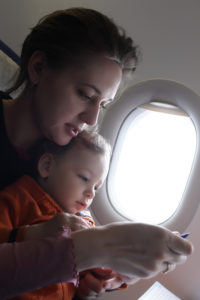 Mother and her toddler are on a flight © Radist | Dreamstime.com