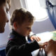 Family playing with a board game on a flight © Radist   Dreamstime.com
