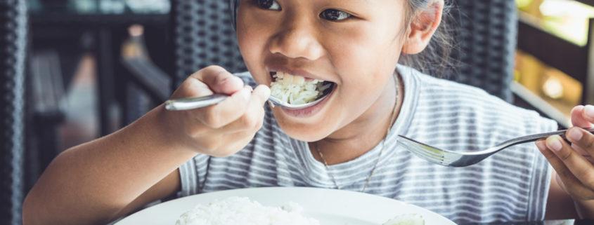 Kid eating in a restaurant © Phanuwatn | Dreamstime.com