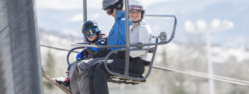 Family on Ski Lift © Rachel Hopper | Dreamstime.com