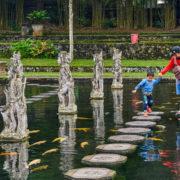 Family at Tirta Gangga water palace in Bali © Alexey Pelikh   Dreamstime.com