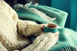 Woman holding cup of tea with lemon © Yuliia Chyzhevska | Dreamstime.com