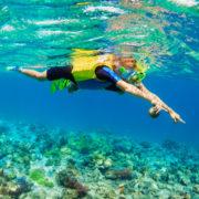 Mother, kid in snorkeling mask dive underwater. Photo: Denis Moskvinov | Dreamstime.com