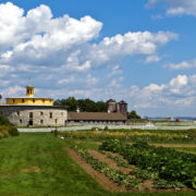 The Round Barn and vegetable patch at Hancock Shaker Village, an open air museum and historical tourist attraction in the Berkshires of Massachusetts © Reinout Van Wagtendonk | Dreamstime.com