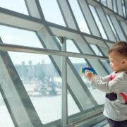 Little kid waiting for flight.
