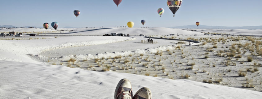 Watching Balloon Fiesta on White Sands National Monument. Photo: Tjeerd Kruse | Dreamstime.com