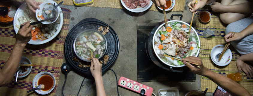 Family eating Shabu and Barbecue together.