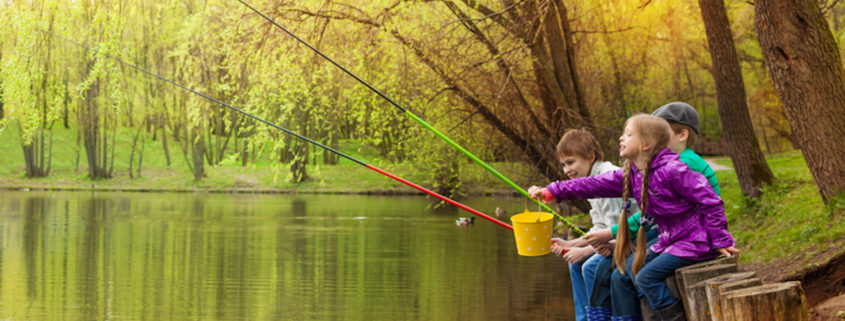 kids sitting and fishing together.