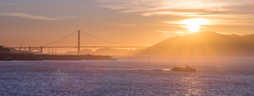 A tourist cruise sails in San Francisco Bay at Sunset. Photo: Phitha Tanpairoj | Dreamstime.com