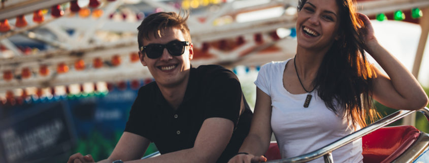 Siblings at an Amusement Park.