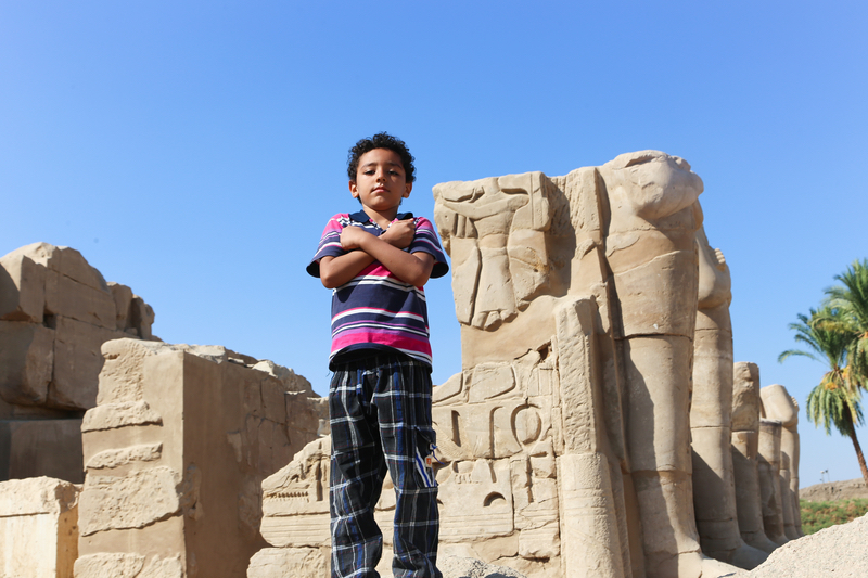 Young boy at Karnak Temple ing Luxor, Egypt.
