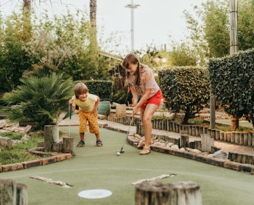 Kids playing mini golf.