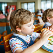 Kids eating on a cruise ship.