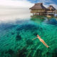 Swimming in coral lagoon at a resort on Moorea, Tahiti.