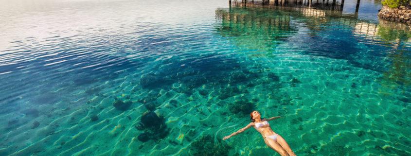 Swimming in coral lagoon at a resort on Moorea, Tahiti.