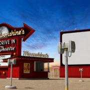 Traditional 1950s drive-in movie theater, cinema at dusk.