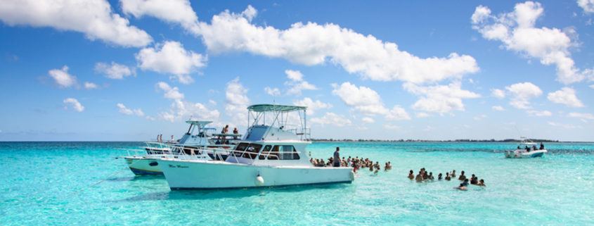 Tourists visiting Stingray city on Gran Cayman in George town, Cayman Islands.