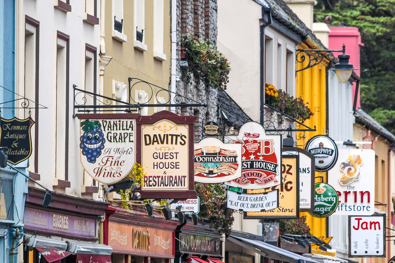 Colorful pub signs in Kenmare, County Kerry, Ireland.