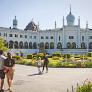 Tourists in front of the Moorish Palace at Tivoli Gardens in Copenhagen.