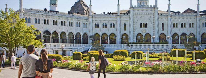 Tourists in front of the Moorish Palace at Tivoli Gardens in Copenhagen.