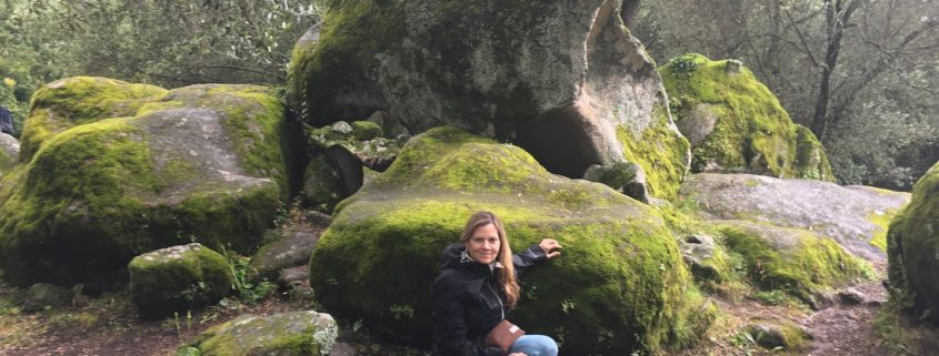 Author Debra Bokur with ancient stones in Corsica